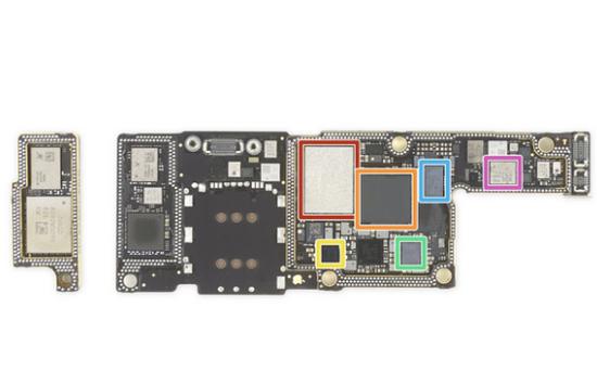 ▲iPhone XS 主板,橙色部分为基带芯片. 图片来自:iFixit